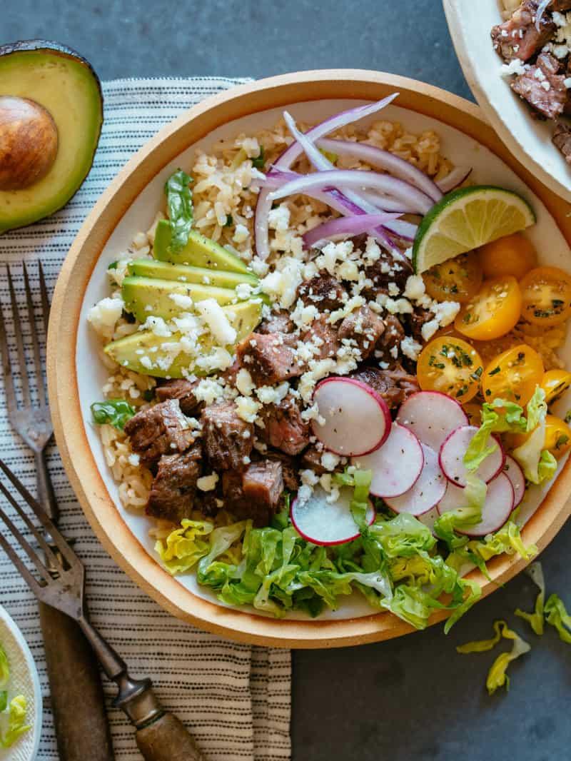 Carne asada bowl with forks.