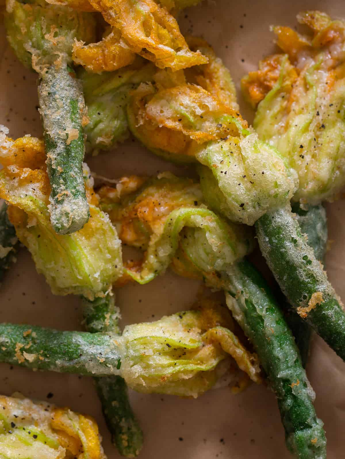 A close up of stuffed and fried squash blossoms.