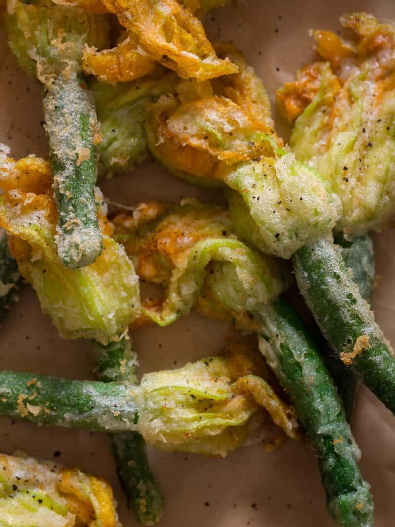A close up of fried squash blossoms.