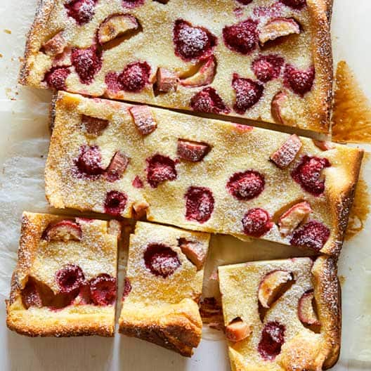 A close up on a raspberry and rhubarb clafoutis.