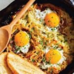 Cheesy Skillet Hash Brown and Eggs recipe with white toast ready to be eaten.