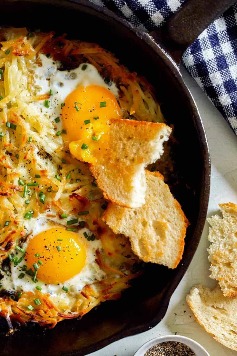 Simple hash browns and eggs in a cast iron skillet.