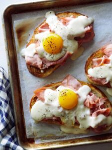 Close up of Croque Madame Toast on a baking sheet.