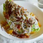 An everything bagel seasoning wedge salad in a bowl.