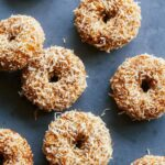 Baked pumpkin cake doughnuts with maple glaze and toasted coconut.