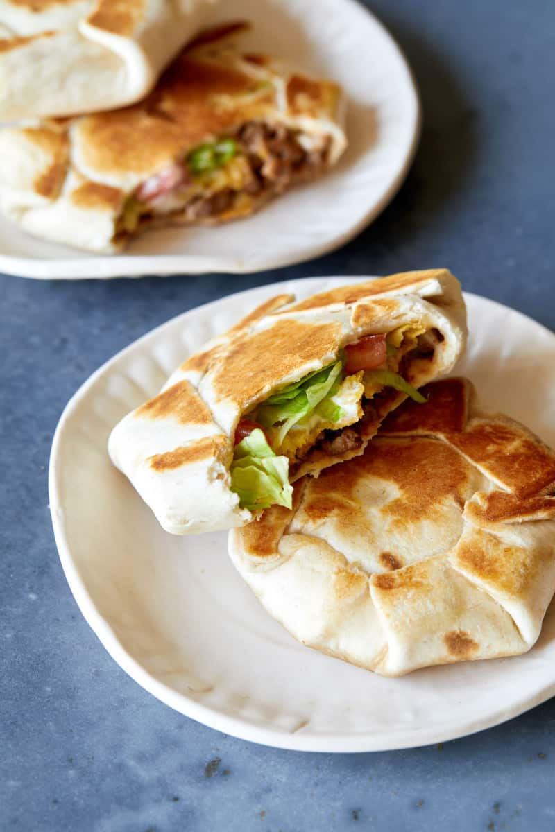 Small plates of mini crunchwrap supremes.