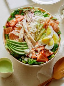 Strawberry cobb salad with dressing on the side.