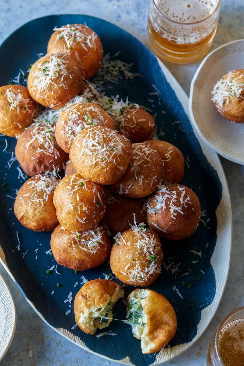 A platter of spinach artichoke stuffed beignets.