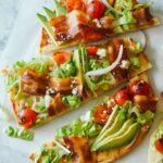 A sliced grilled BLTA flatbread.