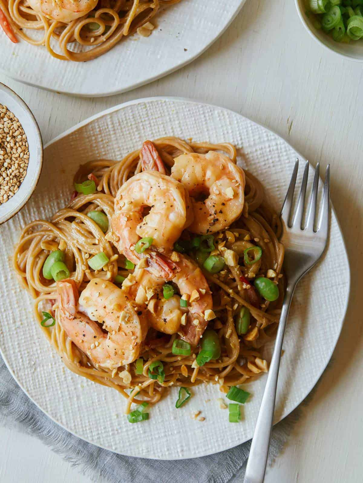 Cold Soba Noodles with shrimp and peanut sauce with a fork on the side.