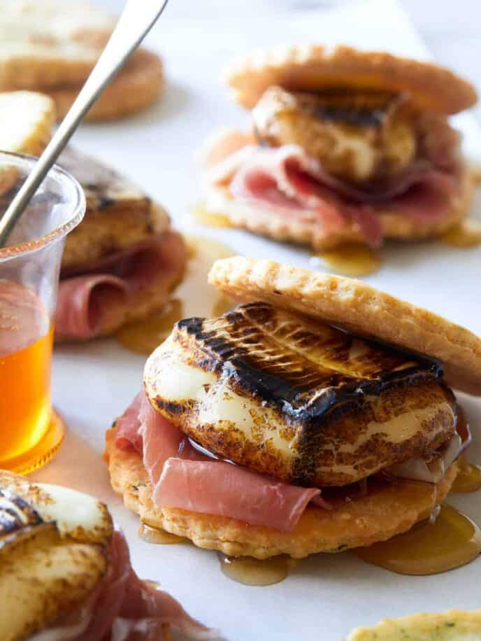 A close up of savory smores with honey.