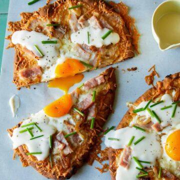 Croque madame flatbread, cut in half with a runny egg yolk.