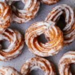 A close up of pumpkin crullers with vanilla bean glaze.