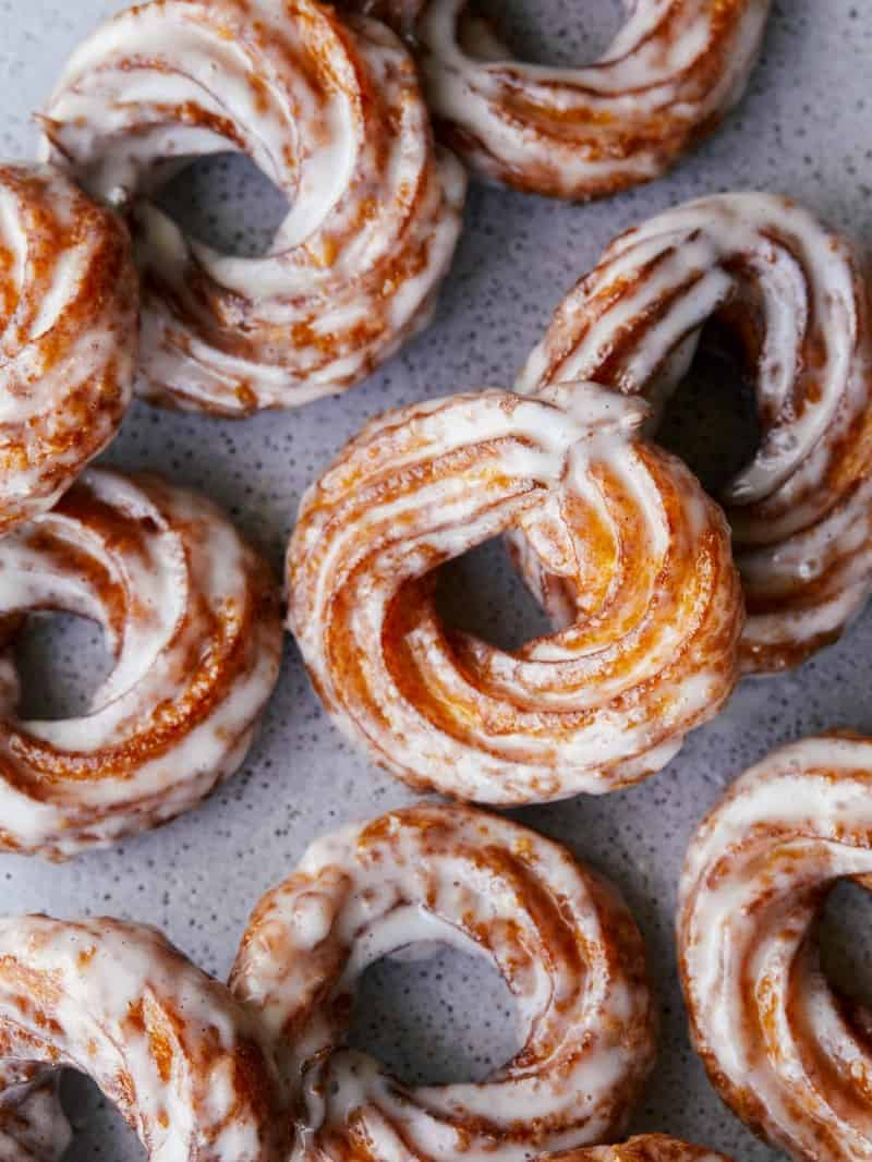A close up of pumpkin crullers with vanilla bean glaze.