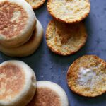 Homemade full and halved English muffins.