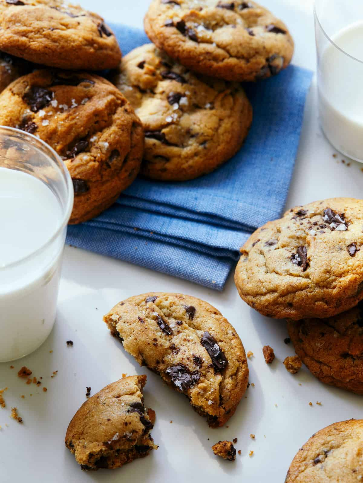 A close up of salted brown butter chocolate chips cookies and milk.
