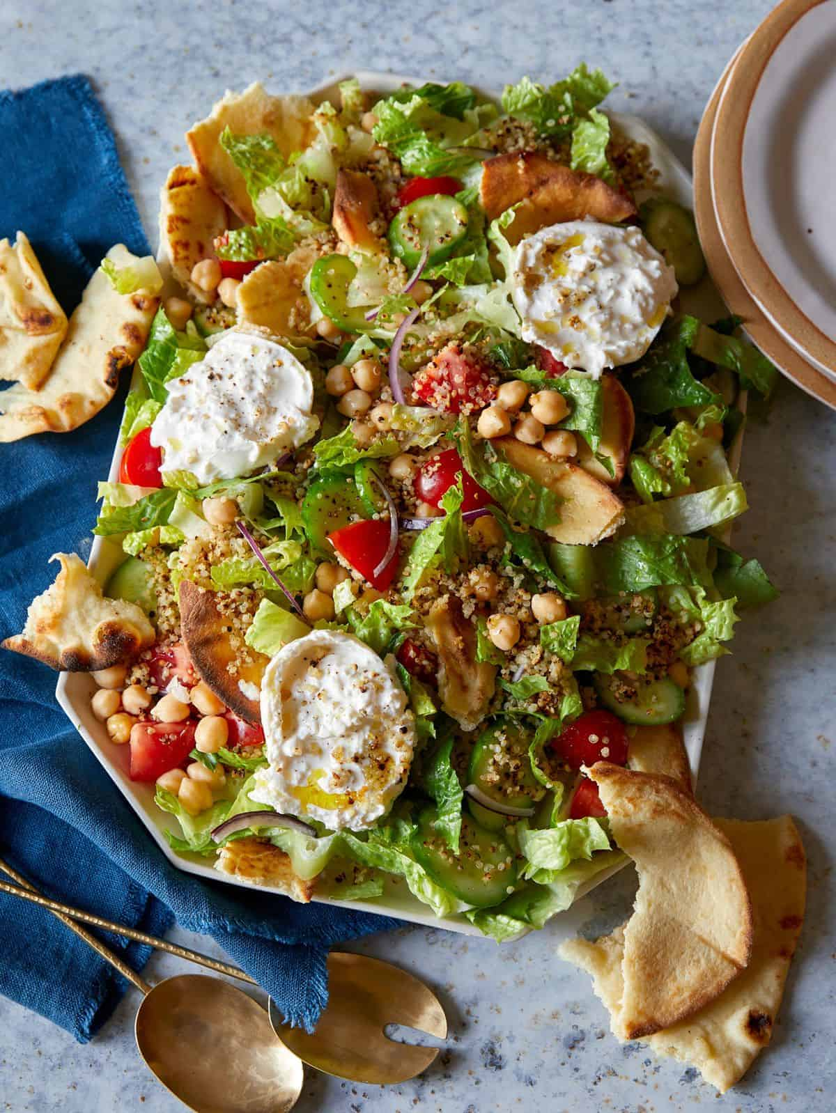 Fattoush style salad with crispy quinoa on a platter.