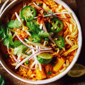 Spicy chicken laksa in a bowl.