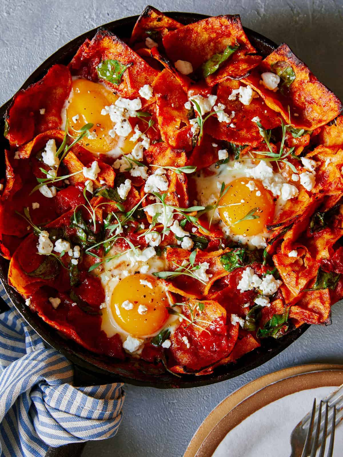 Shakshuka chilaquiles in a pan.