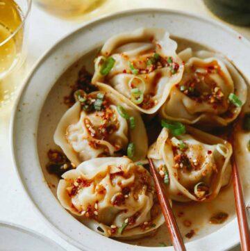 Pork and shrimp dumplings with chopsticks.