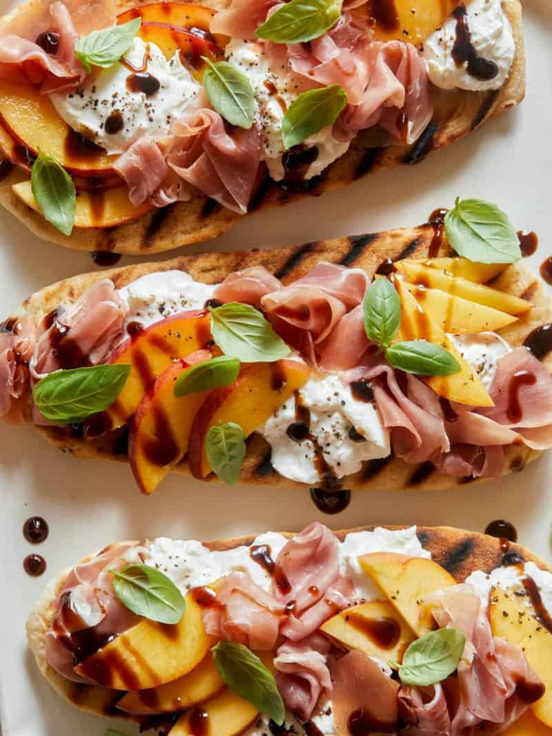 Grilled Flatbreads Topped with Peach, Prosciutto and Burrata
