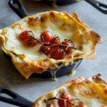 Individual creamy turkey and kale skillet lasagnes.