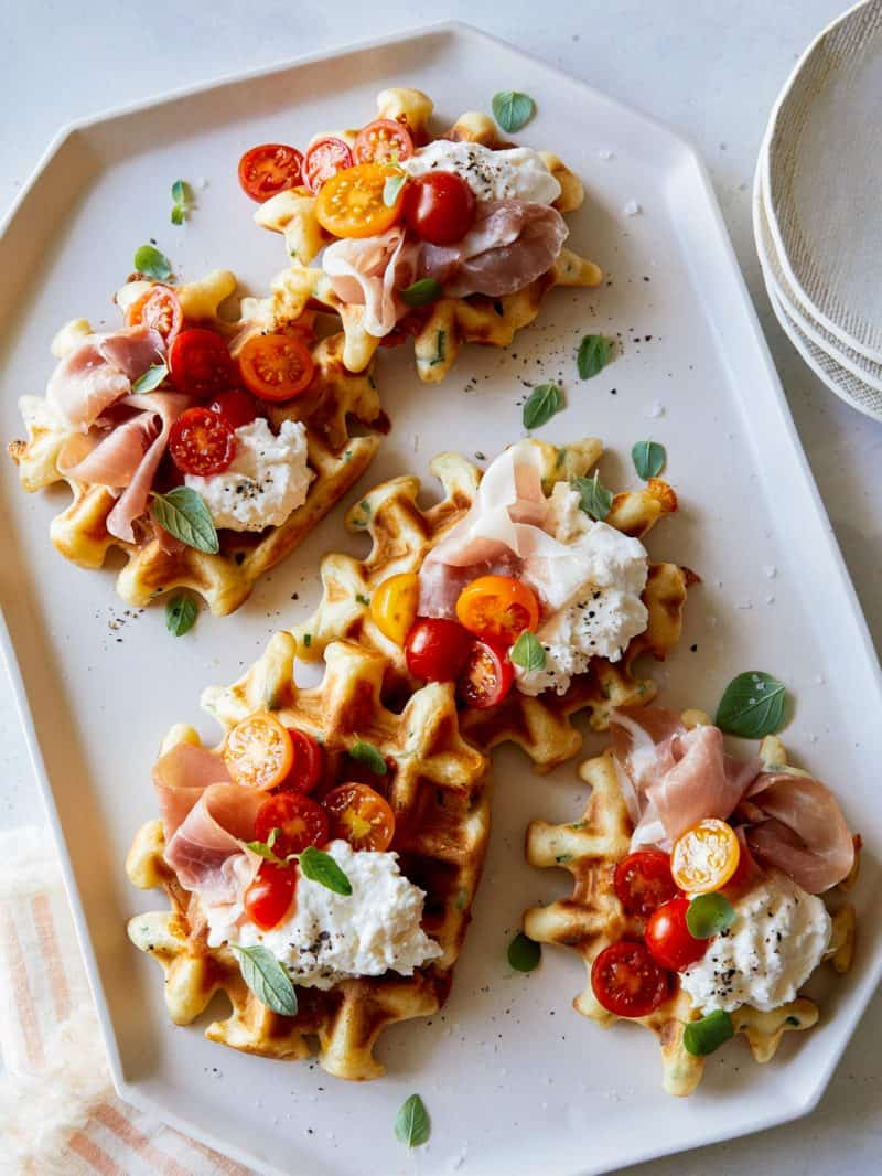 A Savory waffle recipe topped with prosciutto and burrata.