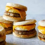 Stacked turkey sausage, egg and cheese breakfast sandwiches.