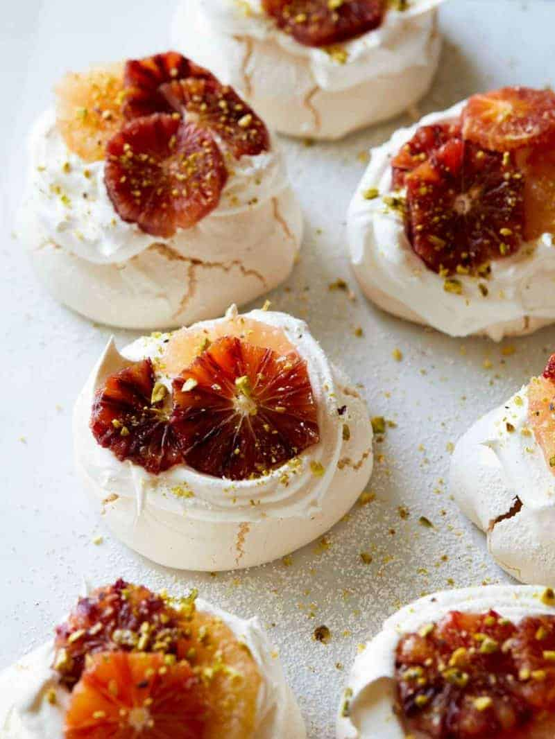 Mini pavlovas with citrus on top.