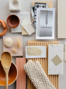 Kitchen renovation mood board with neutral colors and several textures.