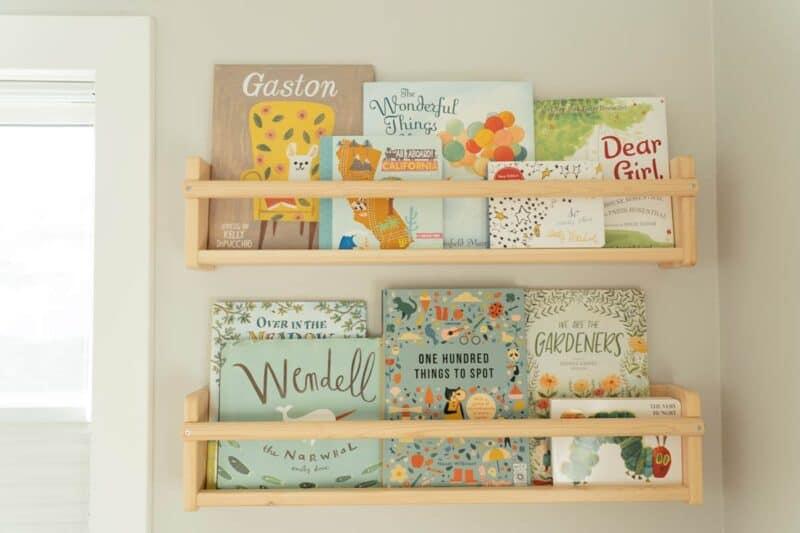 Nursery shelves with children\'s books.