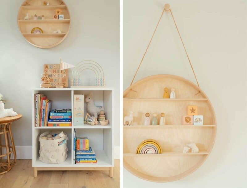 Nursery wall decor and book shelves filled with toys and books.