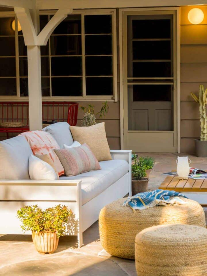 A furnished patio with a couch and table.