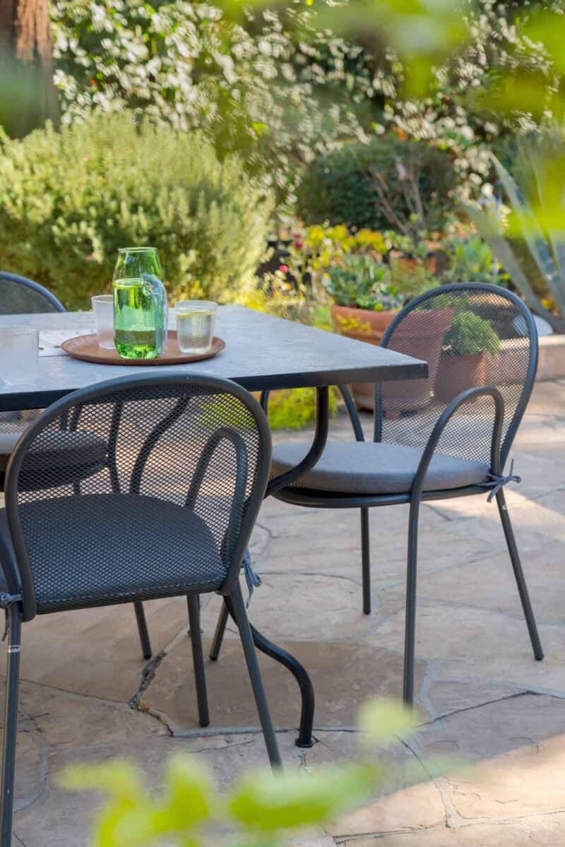 Outdoor dining table and chairs and drinks.