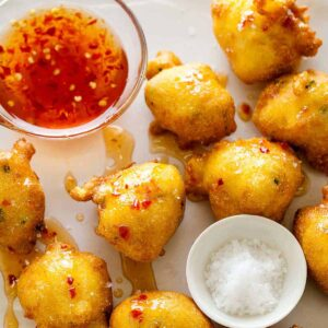 Hush puppies recipe with a sweet and spicy sauce.