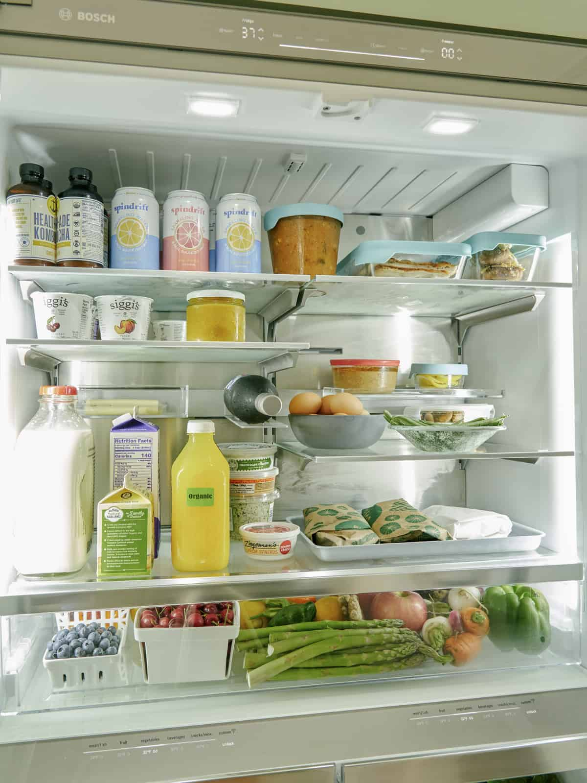 The inside of a refrigerator filled with food and drinks.