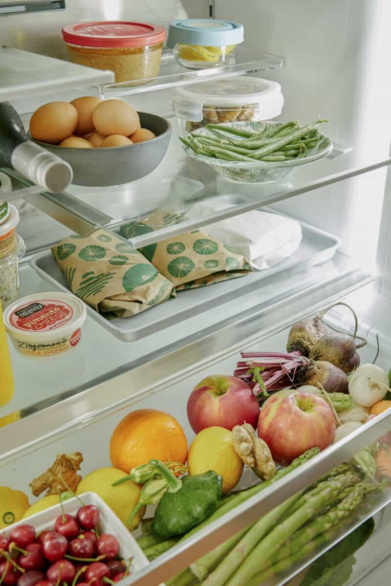 Refrigerator shelves with food.
