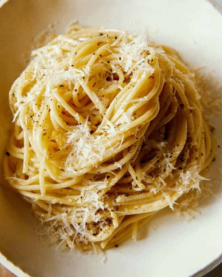 A close up of a swirled pile of cacio e pepe.