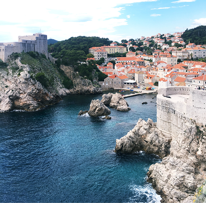 A body of water with Dubrovnik in the background.