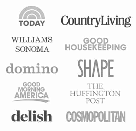 A complication of logos showcasing where Spoon Fork Bacon has been featured. Including delish, today show, cosmopolitan, good morning america, domino, good housekeeping, william sonoma, and country living.