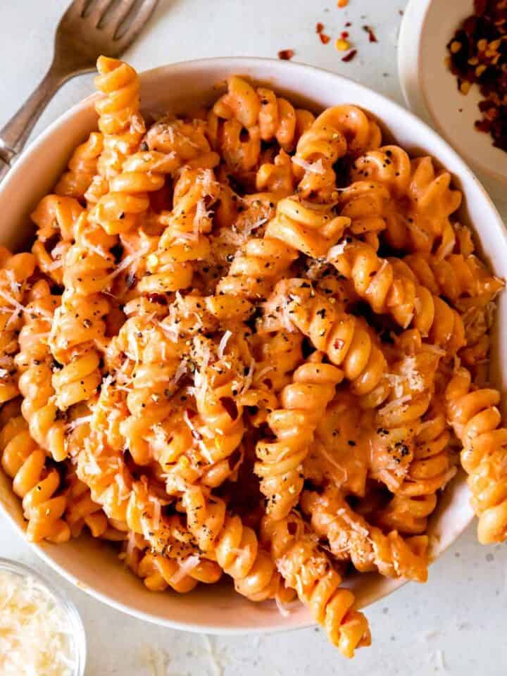 A close up of a bowl of fusilli pasta with vodka sauce.
