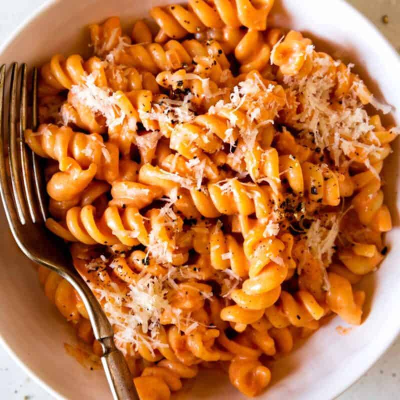 Homemade vodka sauce recipe in a bowl with pasta and a fork in it.