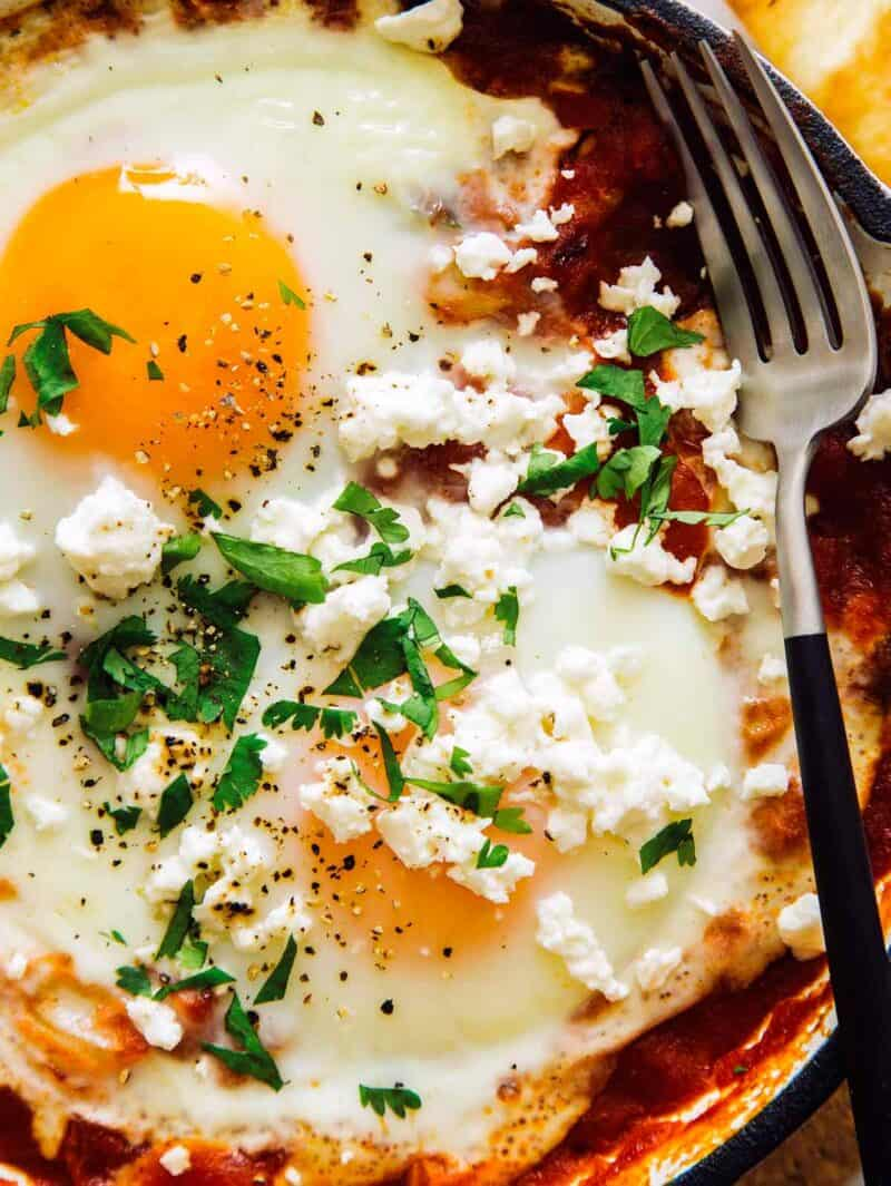 A close up image on the shakshuka recipe with feta and cilantro.
