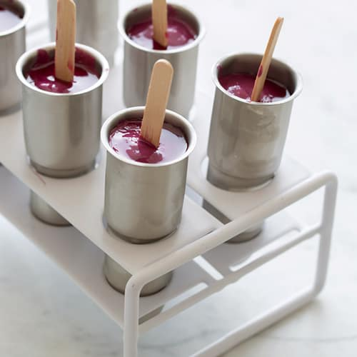 Real fruit bomb pops in stainless steel popsicle mold.