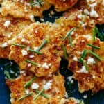 Close up of corn cakes with chives and queso fresco.