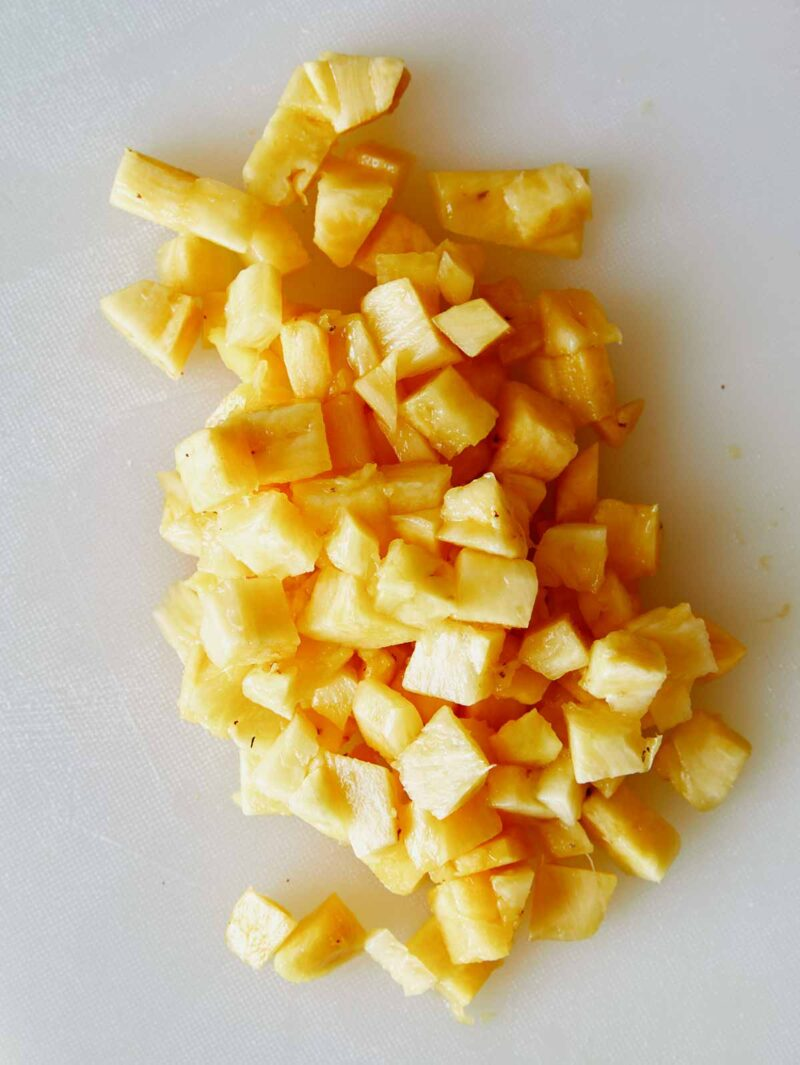 Diced pineapple for piña colada ice pops.