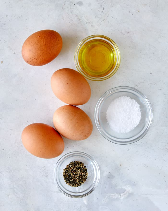 Ingredients to make fried eggs. Eggs, oil, and salt and pepper.
