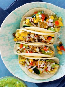 A close up of a plate of grilled zucchini tacos.