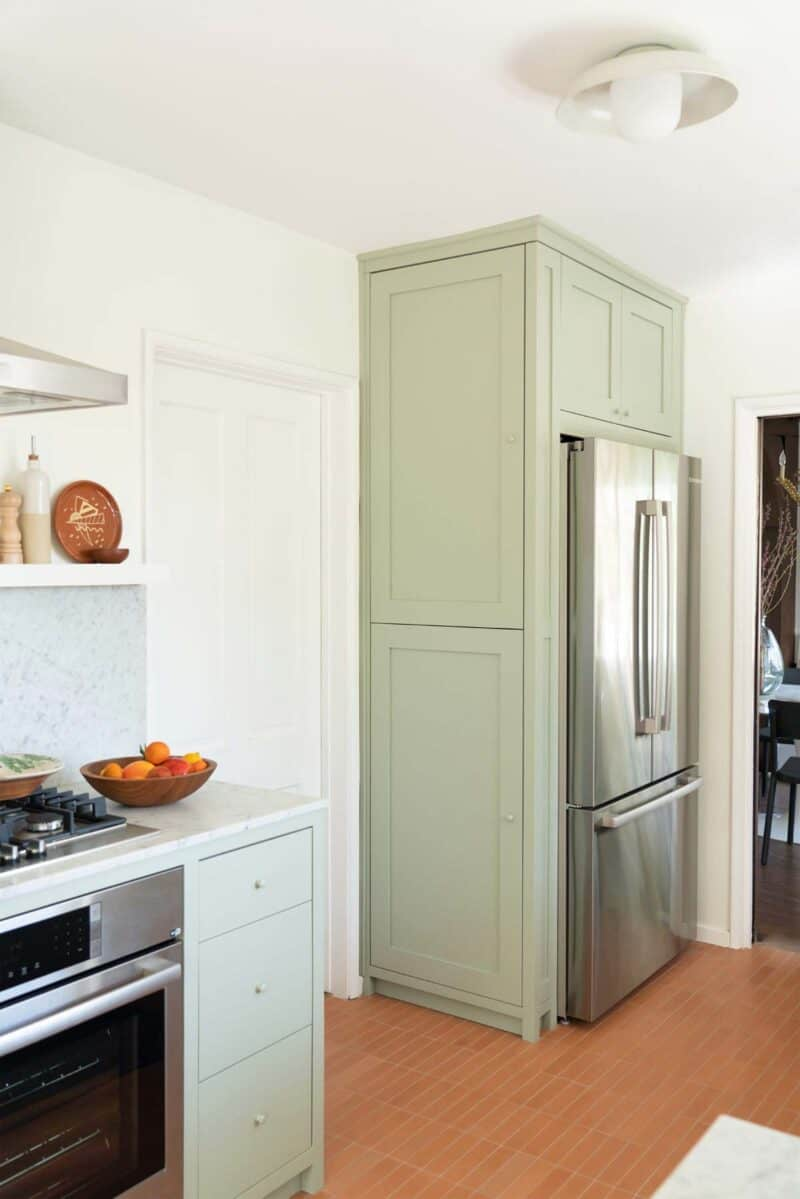A newly remodeled kitchen with a view of a french door refrigerator.