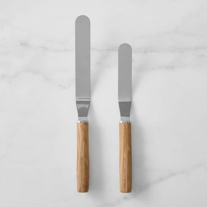 Two different sized wooden handled offset spatulas.